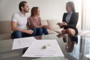 Couple Discussing rent with Real estate broker